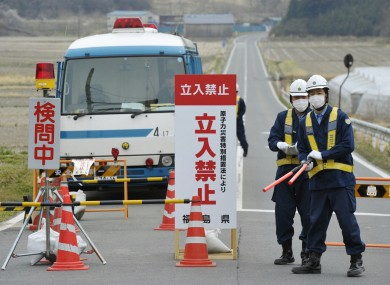 Police officers man a checkpoint in Minamisoma, about 20km from the crippled Fukushima I nuclear power plant.